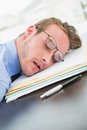 Tired Businessman With Stack Of Files On Desk Royalty Free Stock Photography - 49235787