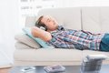Man Napping On Sofa With Music Stock Photos - 49237383