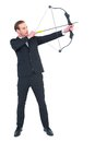 Focused Businessman Shooting A Bow And Arrow Stock Image - 49239641