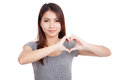 Young Asian Woman  Gesturing  Heart Hand Sign Royalty Free Stock Photography - 49240547
