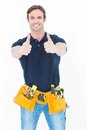Man Wearing Tool Belt While Showing Thumbs Up Sign Stock Image - 49245131