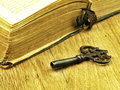 Key And Old, Open Book With A Damaged Cover. Royalty Free Stock Photography - 49263087