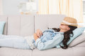Pretty Brunette Relaxing On The Couch Royalty Free Stock Photography - 49277697