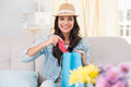 Pretty Brunette Opening Shopping Bag Stock Photography - 49277742