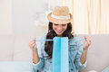 Pretty Brunette Looking In Shopping Bag Stock Image - 49277781