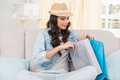 Pretty Brunette Looking At Shopping Bags Stock Photos - 49277803