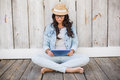 Pretty Hipster Sitting On Ground With Tablet Stock Images - 49278214