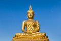 Big Golden Buddha Statue Sitting On Blue Sky Background Royalty Free Stock Image - 49283776
