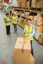 Warehouse Worker Sealing Cardboard Boxes For Shipping Royalty Free Stock Photography - 49296397