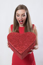 Surprised Young Woman Holding A Big Heart Present Valentine S Day Stock Photo - 49311030