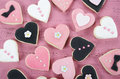 Pink, Black And White Homemade Heart Shape Cookies On Vintage Shabby Chic Pink Wood Background Royalty Free Stock Images - 49316589