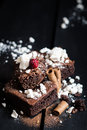 Homemade Double Chocolate Cake With Crushed Meringues, Wafer Rolls And A Ripe Berry On Top Stock Photography - 49340672