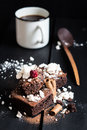 Homemade Double Chocolate Cake With Crushed Meringues, Wafer Rolls, A Ripe Berry On Top And Coffee Royalty Free Stock Image - 49340686