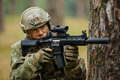 Soldier Holding A Gun Aiming Through The Scope Royalty Free Stock Photography - 49347527