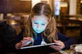 Girl Playing On Tablet Stock Photo - 49387800