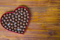 Heart Shaped Box Filled With Small Chocolates Balls Royalty Free Stock Image - 49392626