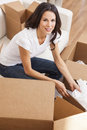 Single Woman Unpacking Packing Boxes Moving House Royalty Free Stock Image - 49406896