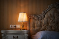 Lamp On A Night Table Next To A Bed Stock Images - 49416614
