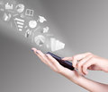 Hand Holding Smart Mobile Phone And Exchange Symbols Flying Away Royalty Free Stock Photo - 49426765