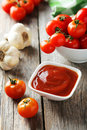 Fresh Cherry Tomatoes With Bowl Of Ketchup On A Grey Wooden Background Royalty Free Stock Photo - 49427495