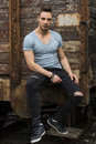 Young Man Sitting Against Old Rusty Train Stock Photos - 49430993
