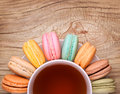 Colorful French Macarons With Cup Of Tea Royalty Free Stock Photography - 49443107