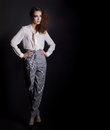 Beautiful Girl In Shirt And Trousers In Business Style In The Studio On A Black Background, Im A Hair And Make-up Royalty Free Stock Photography - 49462817