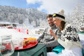 Couple Of Skiers Having Lunch Break On The Slopes Royalty Free Stock Images - 49464639