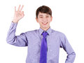 Happy Teen Boy In Shirt And Tie Gesturing OK Sign And Smiling Isolated On White Royalty Free Stock Image - 49465856