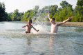 Young Father And Son Swimming In River Stock Image - 49467851