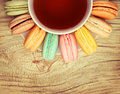 Colorful French Macarons With Cup Of Tea On Wood Background Stock Image - 49483311