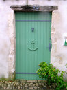 Green Wooden Door In A Seaside Village. Royalty Free Stock Photo - 4951725