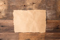 Piece Of Torn Paper On Old Grunge Wood Royalty Free Stock Image - 49516716