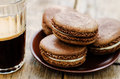 Chocolate Macaron With Cream Cheese And Coffee Royalty Free Stock Photos - 49517718