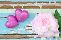 Pink Hearts And Pink Roses On Grungy Light Blue Wooden Backgroun Royalty Free Stock Photos - 49525258