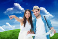 Composite Image Of Happy Hipster Couple Looking At Map Royalty Free Stock Image - 49540016