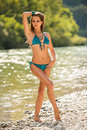 Preety Woman In Swimsuit Near Alpine River In Early Summer Royalty Free Stock Images - 49553679