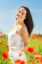 Smiling Young Woman On Poppy Field Stock Images - 49556214