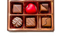 Brown Box Of Chocolate With Assorted Chocolates Stock Images - 49556324