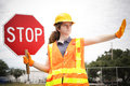 Female Construction Worker Directs Traffic Royalty Free Stock Photos - 49557718