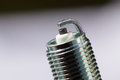 Auto Service. New Spark Plug As Spare Part Of Car. Royalty Free Stock Photo - 49564295