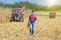 Farmer On Corn Harvest Royalty Free Stock Photo - 49576925
