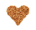 Grains Of Buckwheat In The Form Of Heart On A White Background. Royalty Free Stock Photography - 49583057