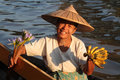 A Woman Selling Fruits And Flower From Her Small Boat Royalty Free Stock Photo - 49586745