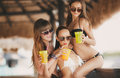 Three Beautiful Girls In A Bar On The Beach Royalty Free Stock Photos - 49631608