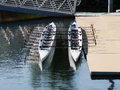 Two Empty Rowing Shells Sitting At Dock Side Stock Images - 49636114
