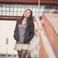 Young Beautiful Chinese Girl Posing In The City Streets Stock Photography - 49664922