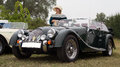 Woman In Vintage Dress And Classical Morgan Sports Car Stock Photography - 49671022