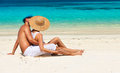 Couple In White Relax On A Beach At Maldives Stock Images - 49689474