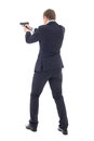 Back View Of Special Agent Man In Business Suit Posing With Gun Royalty Free Stock Images - 49694609
